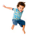 Young Boy Jumping. A cute young boy jumping in the air on white background stock photos