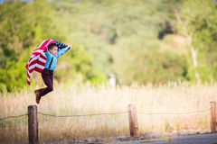 Young boy jumping with an American Flag Stock Photos
