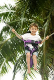 Young boy jumping bungee. On natural background Royalty Free Stock Images