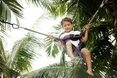 Young boy jumping bungee. On natural background Royalty Free Stock Photography