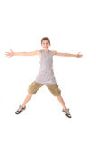 Young boy jumping hands out. Isolated on a white background Stock Image