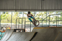 Young boy jumping with his BMX Bike at skate park.  Royalty Free Stock Image