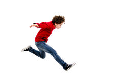 Young boy jumping. Boy jumping isolated on white background Royalty Free Stock Image
