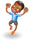 Young boy jumping for joy Stock Image