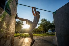 Young boy jumping in the park. Do exercises parkour Stock Photography