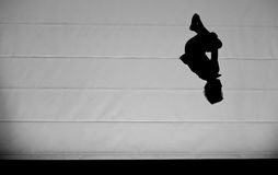 Young boy jumping on trampoline Stock Photo