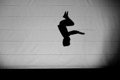 Young boy jumping on trampoline. Young boy jumping a somersault on trampoline Stock Image