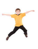 Young boy jumping up. Isolated on white Royalty Free Stock Photography