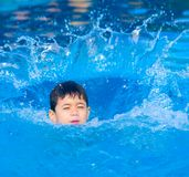 Young boy jumps in the pool Royalty Free Stock Photos