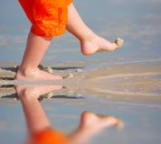 Young Boy Kicking Sand Royalty Free Stock Photos