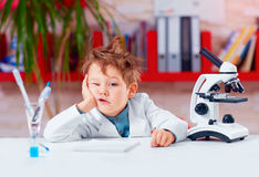 Young boy, kid is bored at practical lesson in the school lab. Education Stock Photos