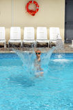 Young boy kid jumping in the pool Royalty Free Stock Photos