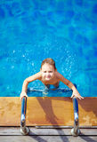 Young boy kid swimming in pool Stock Photo