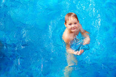 Young boy kid swimming in pool Royalty Free Stock Photos