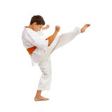 Young boy in kimono making kick Stock Photo