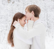 Young boy kisses a girl n forehead Stock Images