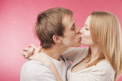 Young boy kissing cute girlfriend Stock Image