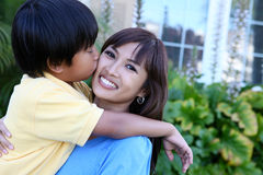 Young Boy Kissing Mother Royalty Free Stock Images
