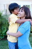 Young Boy Kissing Mother Royalty Free Stock Photography
