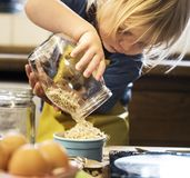 Young boy in the kitchen Stock Images