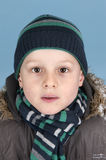 Young boy with kniited jat and scarf Stock Images