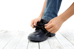 Young boy lace his shoe Stock Images