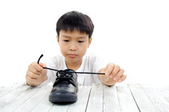Young boy lace his shoe Stock Photos