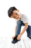 Young boy lacing his Stock Images