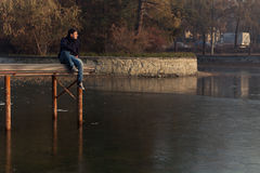Young boy on a lake pier Stock Photography