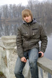 Young boy lakeside Stock Photography