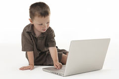 Young boy and lap top Royalty Free Stock Photos