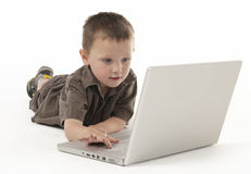 Young boy and lap top Stock Photos