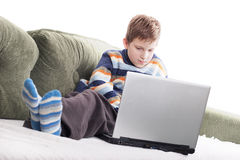 Young boy with laptop Stock Photo