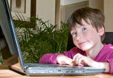 Young boy with laptop stock photos