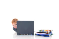 Young boy on laptop Stock Images