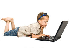 Young boy with laptop. Isolated on white Stock Image