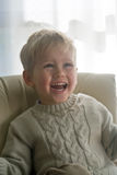 Young boy laughing Stock Photo