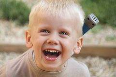 Young boy is laughing royalty free stock photography