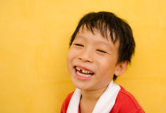 Young boy laughs Royalty Free Stock Images