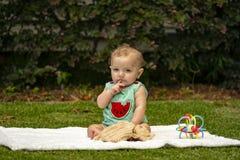 Baby boy on lawn