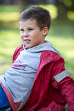 Young boy laying on back in grass, close-up cropped view Stock Photos