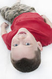 Young boy laying down Royalty Free Stock Image
