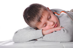 Young boy laying on the floor Royalty Free Stock Photo
