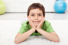 Young boy laying on the floor Stock Photo