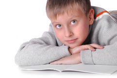Young boy laying on the floor i Stock Image