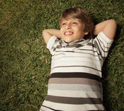 Young boy laying on grass Stock Images