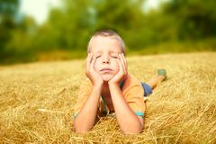 Young boy laying on ground Stock Photo