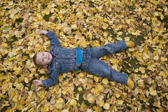 Young boy laying in leaves Stock Photography