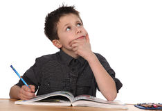 Young boy learning Stock Image