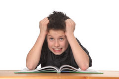 Young boy learning. Young boy frustrated over homework Stock Images